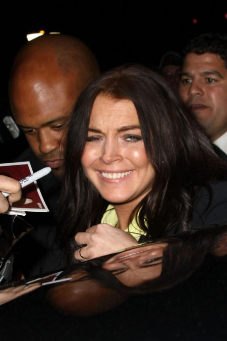 Lindsay Lohan Flashes Belly Flash