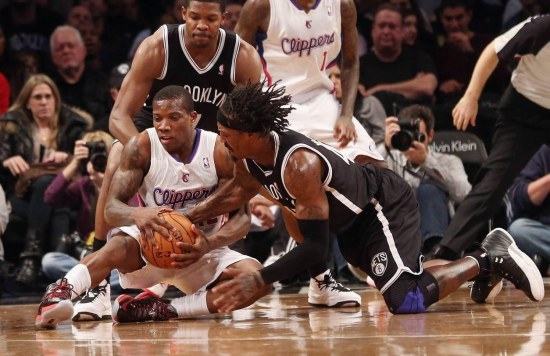 Eric Bledsoe Battles Gerald Wallace For The Loose Ball In Brooklyn