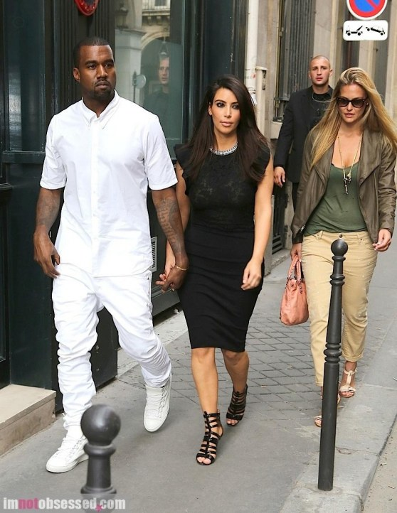 Kim Kardashian And Kanye West Walk Through The City Of Lights Fashion