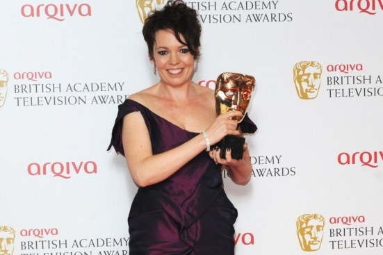 Olivia Colman With Her Bafta For Best Supporting Actress Png