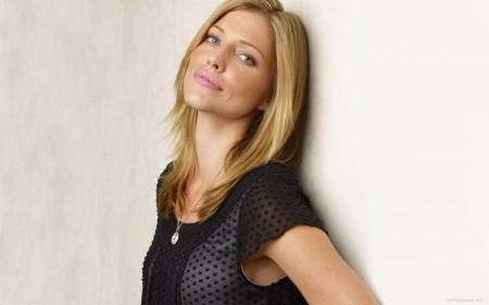 Tricia Helfer Leaning On Wall